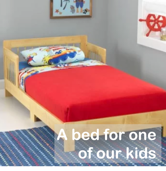A bed & bedding for one of our kids (one-time gift)