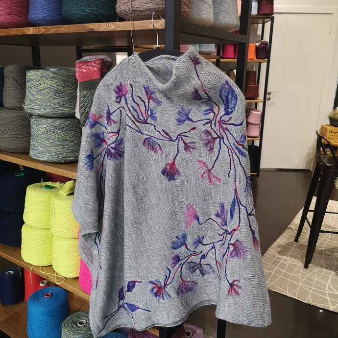 Ponchos with woolen flower design
