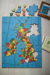 A puzzle of the British Isle counties that is partially made. every County is a separate piece.
