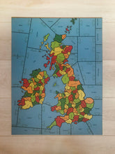 Load image into Gallery viewer, a completed wooden Puzzle showing the Counties of the British isles on a pale wood background.