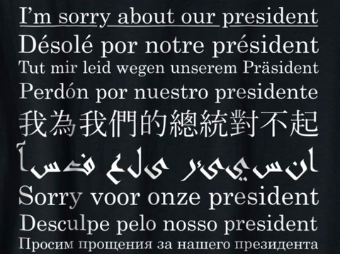 """Sorry About Our President"" Shirt In Different Languages (Black)"