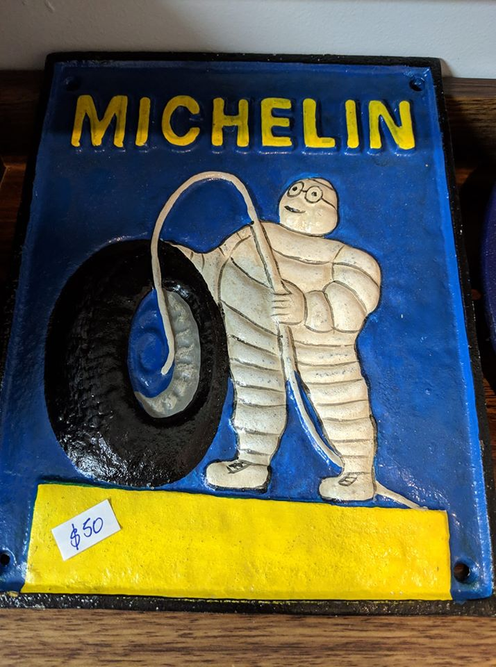 Michelin Man Blowing Up Tyres Cast Iron Sign