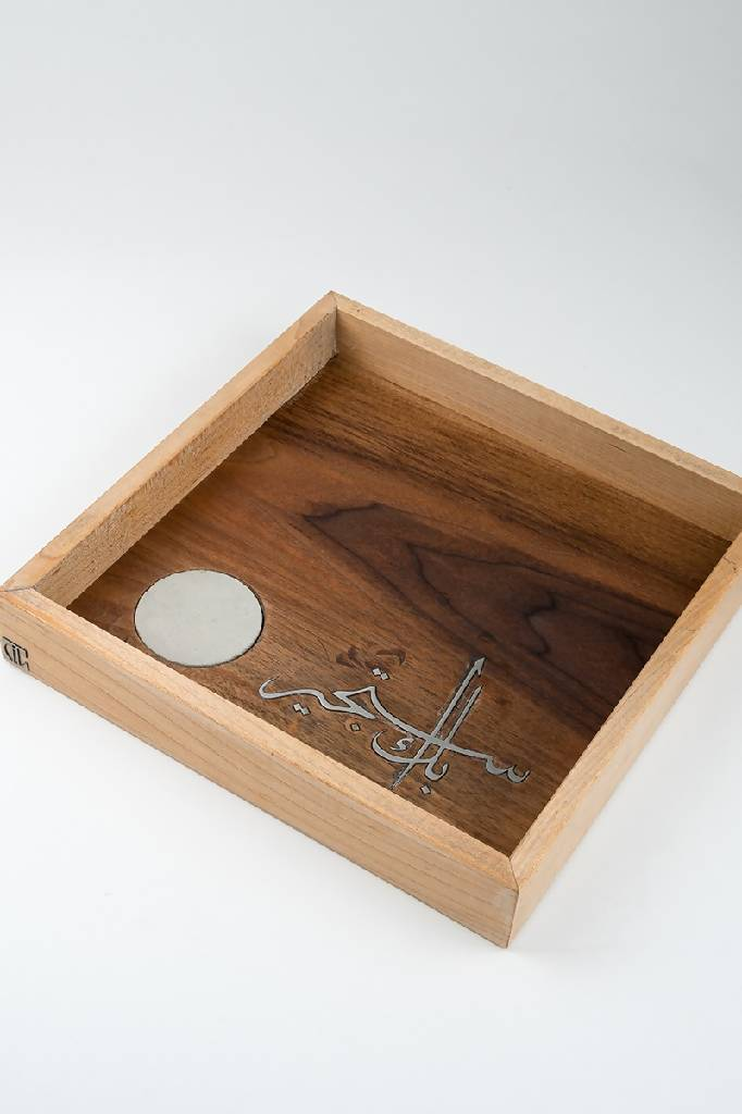 Squared wooden tray with embedded steel