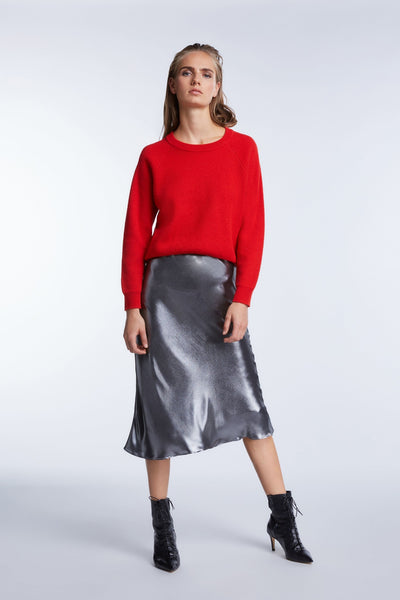 Set metallic silver bias cut skirt which falls below the knee