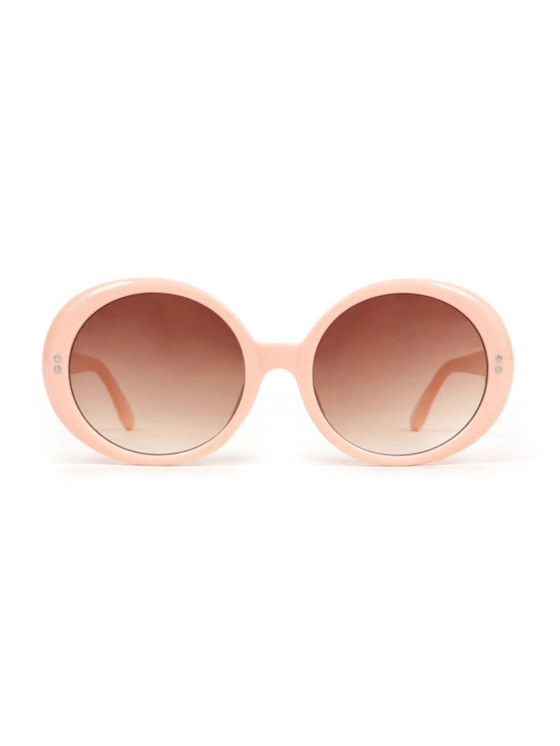 Powder Callie pale pink sunglasses with oval lenses.