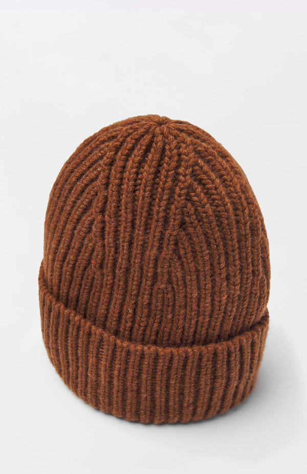 Loreak Burua heavy wool ribbed beanie hat in toffee.