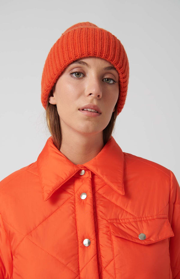 Loreak Burua heavy wool ribbed beanie hat in orange