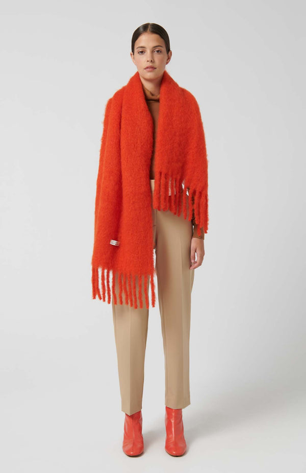 Loreak Allende luxurious mohair blend wide scarf in orange.