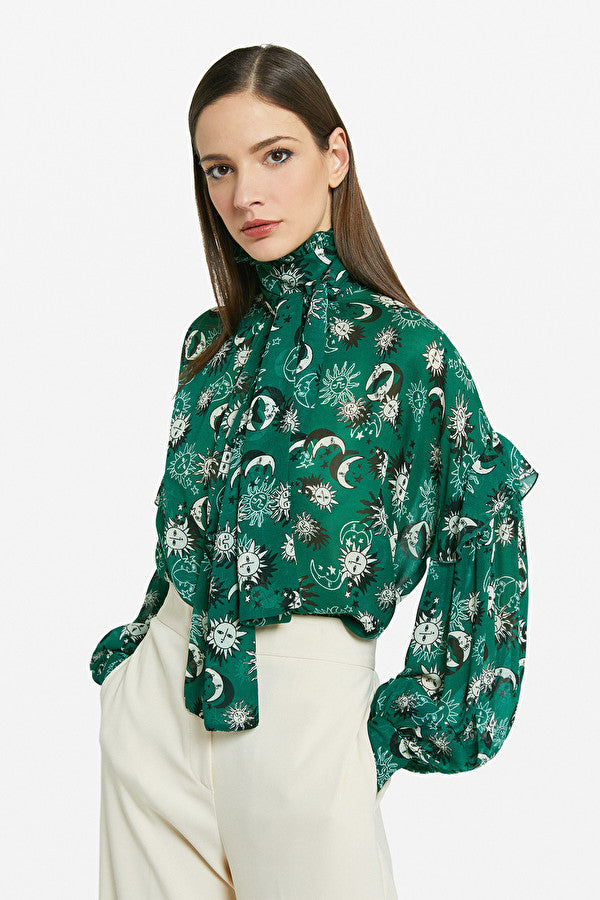 Ottodame Moon and Star Print tie neck blouse in green.