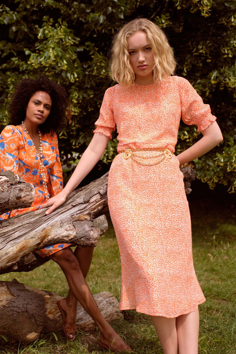 Primrose Park Betty leo printed midi dress in orange with short puff sleeve and tailored shape