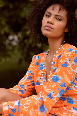 Primrose Park Sandy glorious shirt in bright orange, cream and blue floral and print.