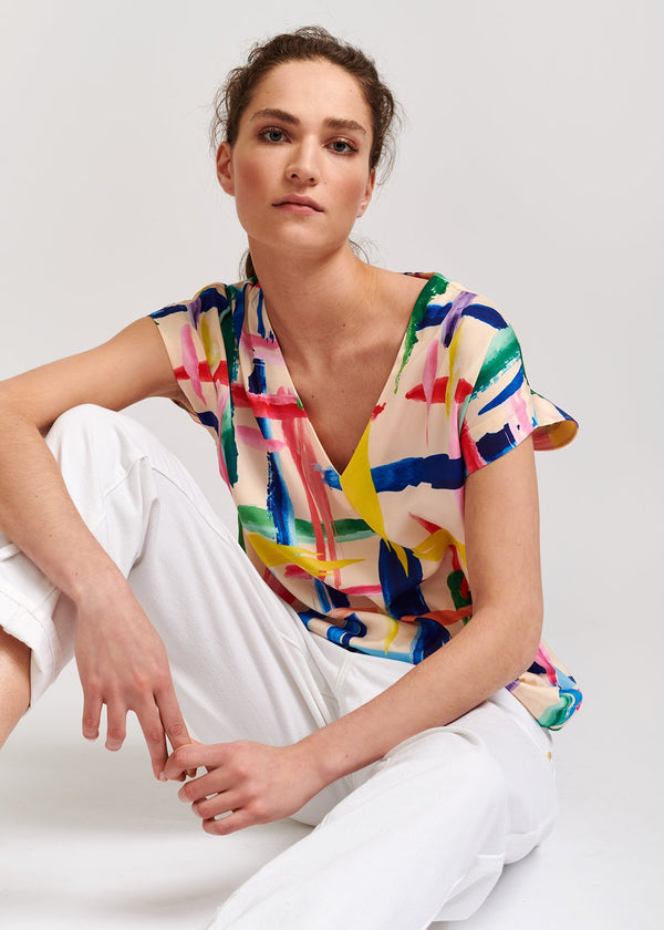 Veda graphic print V-neck tunic style short sleeved top with asymmetric side tie by Essentiel Antwerp