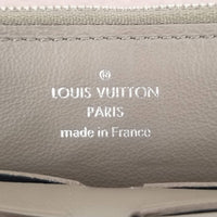 Authentic Louis Vuitton  Capuchines Magnolia Leather Wallet