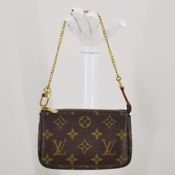 Authentic Louis Vuitton Mini Monogram Pochette Accessoires