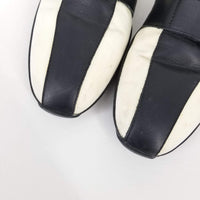 Authentic Gucci Cream/Black Velcro Slip Ons