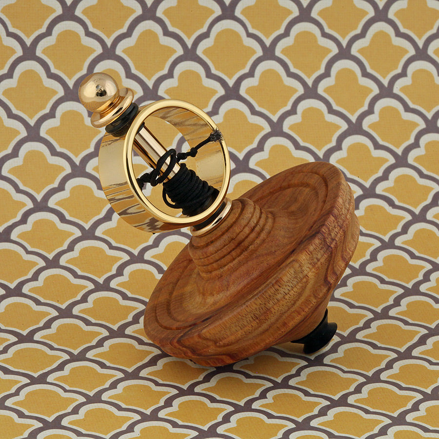 Spinning Top Toy in Canary Wood