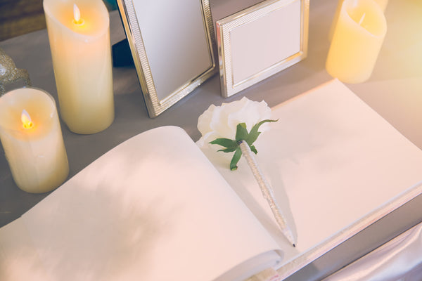 Wedding Guest Book Surrounded by Candles