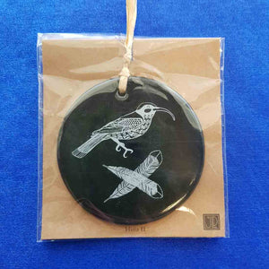 White Huia on Black Round Tile