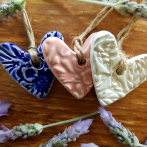 Embossed Ceramic Heart. (assorted colours approx. 4 x 4cm)