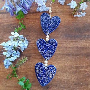3 Blue Embossed Hearts on a String with Beads. (approx. 38 x 8cm to top of string)
