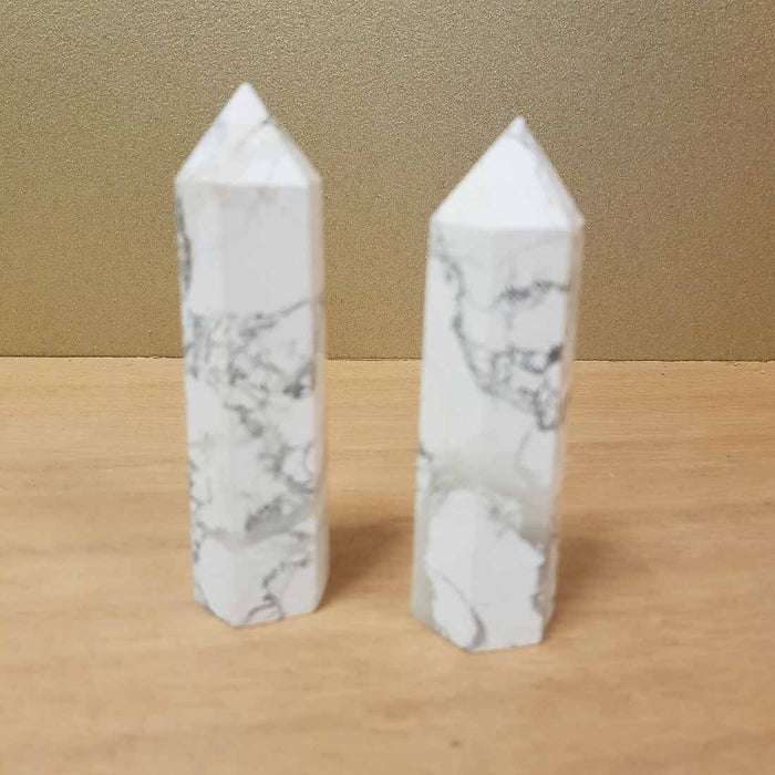 Howlite Polished Point. (assorted approx. 9x2.5cm)