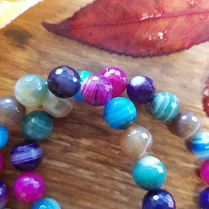 Amazonite Bracelet. (faceted & dyed. assorted. approx. 10mm round beads)