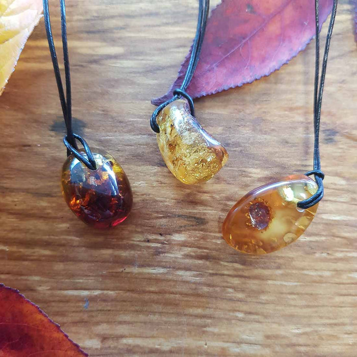 Baltic Amber Pendant. (partially polished. assorted)