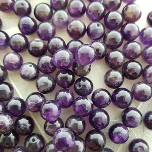 Amethyst Bead. (assorted. round. approx. 8mm)