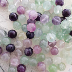 Fluorite Bead (assorted. round. approx. 8mm)