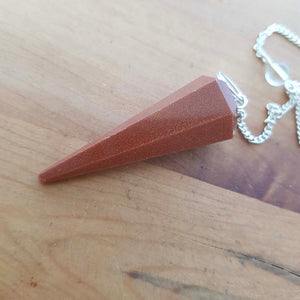 Gold Sandstone Faceted Pendulum (man made. assorted)