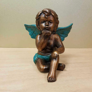 Brown Wash Angel with Teal Wings Blowing a Kiss