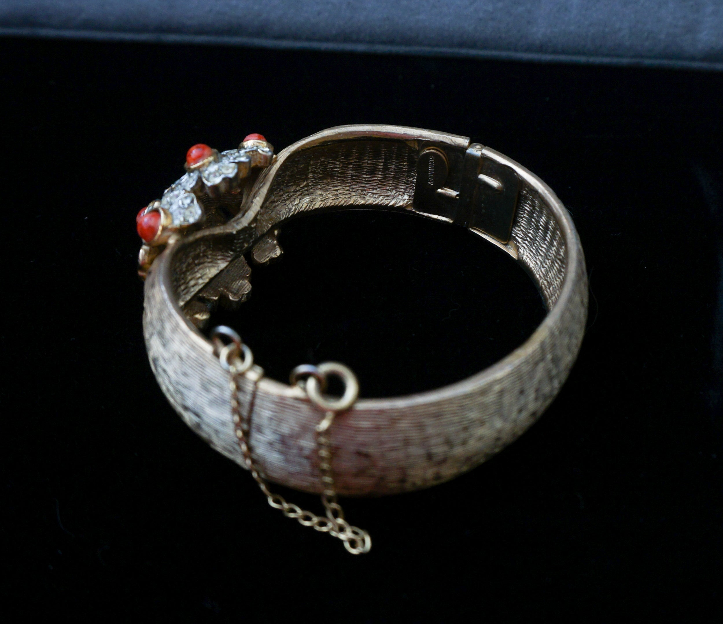 Signed Schrager Hinged Bangle with Flowers of Clear Crystals and Coral Cabochons