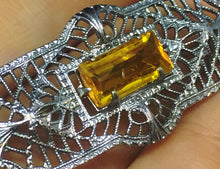 Edwardian pin with topaz baguette