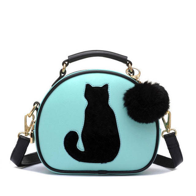 Faux Leather Purse with Cat Silhouette and Pom-Pom Accent Aquamarine | CatToyz.com | Shop Cat Toys, Clothes, and Grooming Supplies