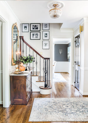 How we hung our stairway gallery wall quickly and easily without any accidental nail holes + inspiration for other gallery walls in the house