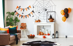 Do all the Halloween decorations you're encountering at local bars and shops, not to mention houses around the neighborhood, have you wondering how you can properly spook up your home for the scary season? Let skeletons and witches be the only thing...