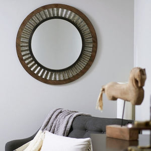 A stylish round wall mirror offers much more than plain functionality