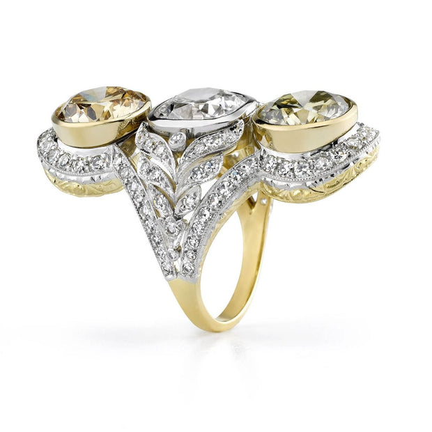 FANCY COLOR DIAMOND, PLATINUM, GOLD THREE STONE RING
