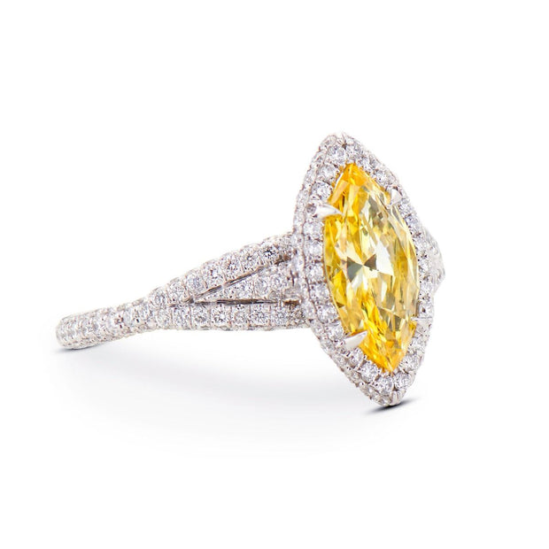 FANCY VIVID YELLOW DIAMOND, PLATINUM RING
