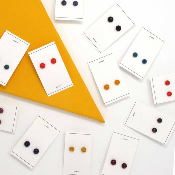 Collection of Katie Kismet glass dot stud earrings in bright colors