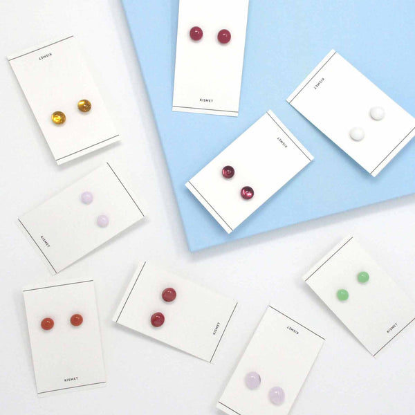 Collection of Katie Kismet glass dot stud earrings in pastel and neutral colors