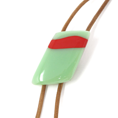 Close up of KISMET's modern bolo tie in mint green and tomato red