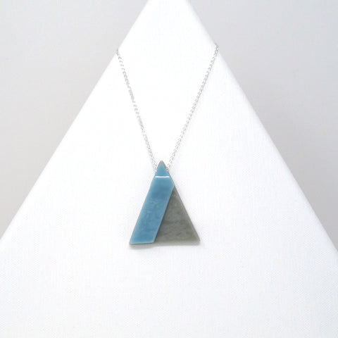 Glass geometric pendant necklace on 32 inch sterling silver chain, triangle in gray and blue