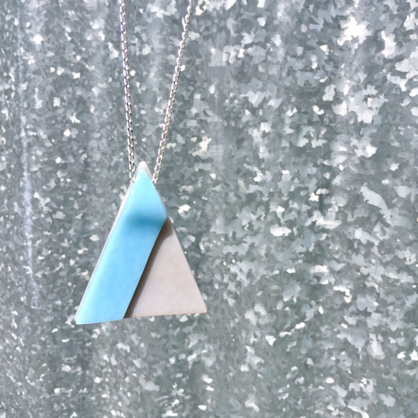 Glass geometric pendant necklace on 32 inch sterling silver chain, gray and blue triangle