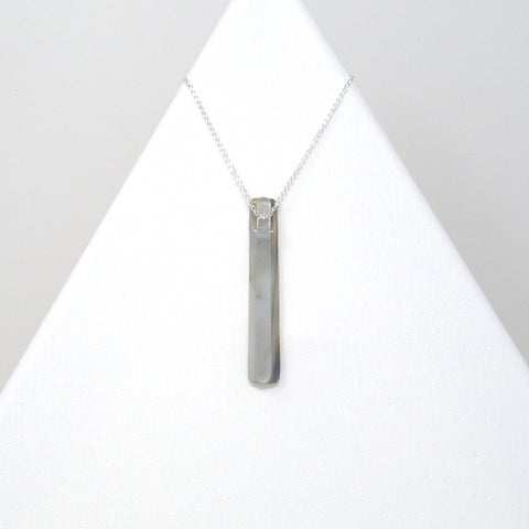 Kismet's handmade glass bar pendant necklace in gray and clear