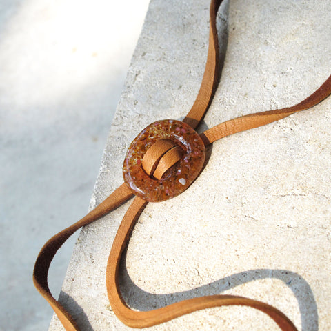 Close up of Katie Kismet Stone Lariat Bolo Tie in Amber for men and women