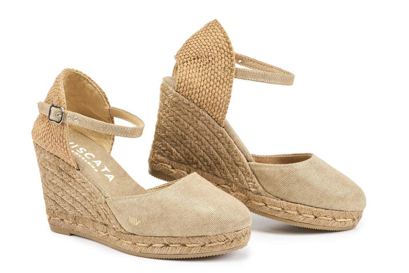 SATUNA WEDGE BY VISCATA  . Breathable linen/cotton fabric . Elegant ankle strap  . Leg enhancing 3-inch espadrille wedge heel that is comfortable enough to wear all day. See reviews  . Soft inner sole cushion . Closed toe all-natural jute midsole