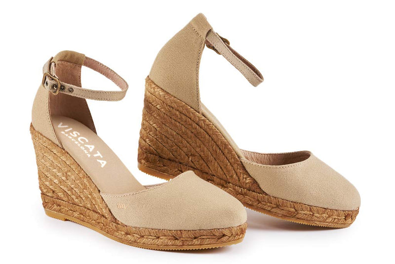 ESTARTIT WEDGE BY VISCATA  . Breathable linen/cotton fabric . Elegant ankle strap  . Leg enhancing 3-inch espadrille wedge heel that is comfortable enough to wear all day. See reviews  . Soft inner sole cushion . Closed toe all-natural jute midsole
