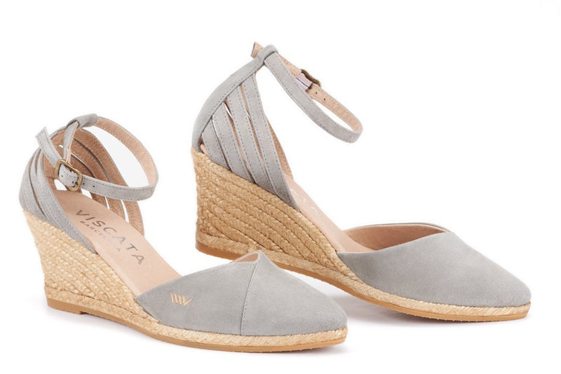ULLASTRET SUEDE WEDGE BY VISCATA  . Premium and soft suede . Elegant and fashionable ankle strap  . Leg enhancing 3-inch espadrille wedge heel that is comfortable enough to wear all day. See reviews  . Soft leather innersole cushion . Closed toe all-natural jute mid sole