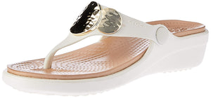 To wedge or to flip? Why not both! Explore a bit more exotic look without forfeiting the delightful, lightweight comfort of our popular Sanrah Sandals—now in a wedge flip, for that extra lift you crave. Featuring a faux-hammered metallic gold embellishment and the all-day wearability of Dual Crocs Comfort™ in that easy-going flip style you love. Sanrah is the perfect statement to make this spring, summer and beyond!